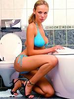 Wet blonde with bikini goes nude