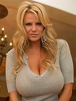Kelly gives a blowjob and titty fucks a big cock.