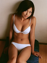 Delicious asian hottie shows off her curves in her blue lingerie