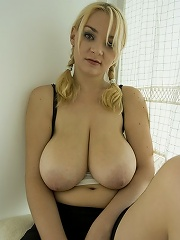 She lets her soft big breasts out for you to squeeze and suck