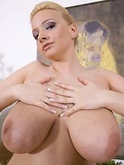 Busty blonde sweeps nude