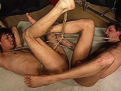 Two slaves bouncing on a huge double-headed dildo