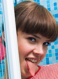 Teen girl takes a shower.