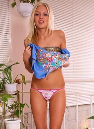 Pretty and petite blonde teen showing off her little body
