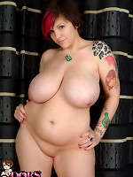 BBW slut squeezes her huge tits and ass into a tiny swimsuit