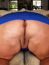 This sexy southern sluts name is Shugar. Shes got cleevage so long and deep even the biggest cock would be lost in between her massive, monstrous moun