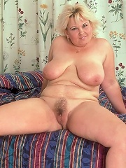 Live clip of sexy mature blonde taking off her clothes and showing off her hairy muff