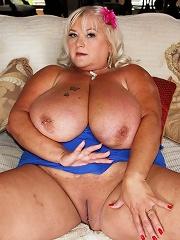Shugar is one hot mature blonde plumper babe. She loves to take on big black cock. Her huge natural rack of tits and big belly got so