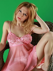 Cute busty blonde babe taking off her pink dress and sheer panties