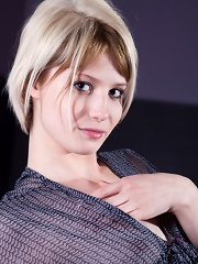 Bewitching and short haired blonde with small mammaries is showing her tits
