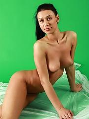 Brunette naked babe posing naked in gymnastic poses