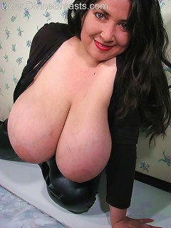 Sexy latina with large breasts in black