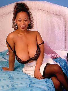 Ebony beautiful women showing off their enormous natural melons.