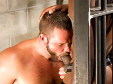 Hairy muscle bear sucks a black dicks in a jail and gets fucked in the ass