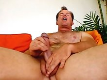 Frank Towers tugs at his cock