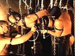 Three big gay men in leather in a hot bondage sex scene
