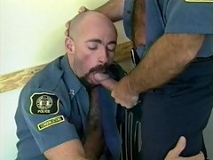 Teasing only leads to head giving when it's between two studly bear cops like these