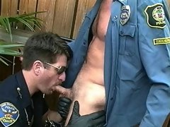 After his dick got licked up and down, this policeman licks a stiffy up and down