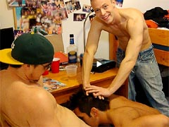Two college boys enjoy their roommate sucking cock in a dorm room