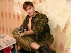 A cute soldier with a gun posing naked here