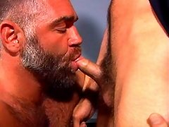 Big muscle daddy licks an ass and sucks a cock of this horny gay cop