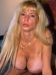 Moon sized tits adorn this lovely MILFs chest!