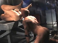Jake Deckard emerges and finds Aaron Action grinding down a large metal structure. As Jake approaches from behind, Aaron puts down his tools, strips o