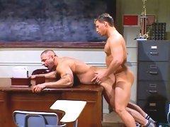 Jock Zachery Scott fucks his coach Mike Radcliff from behind over a desk