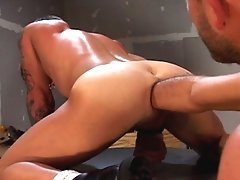 Chris Neal finds himself on a sawhorse watching Taurus Dean lube up his talented hands. Taurus really loves ass, and knows how to handle a good ass, a