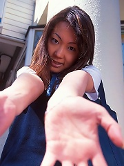 Lovely and shy Japanese teenager is playing with her dildo at home