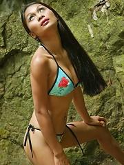 Hot Asian Tailynn in a skimpy bikini by the waterfall