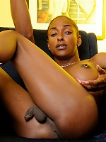 Chocolate tgirl Natalia Coxxx exposing her tight booty
