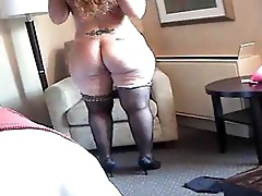 Fat Redhead Playing In The Hotel Bed