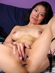 Thin asian lady put 2 fingers deep inside her shaved pussy