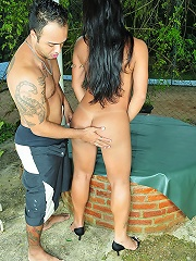 Brazilian shemale fucks her stud outdoors by the pool