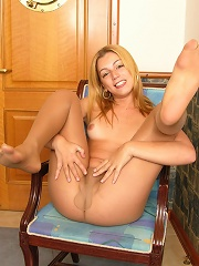 Cute coed shemale spreading her pantyhose clad legs to show stiff surprise