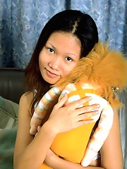 Asian teen spreads her tight wet pussy